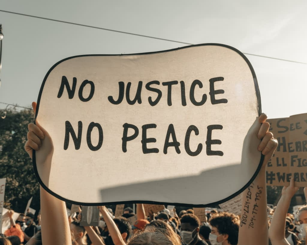 No Justice, No Peace sign